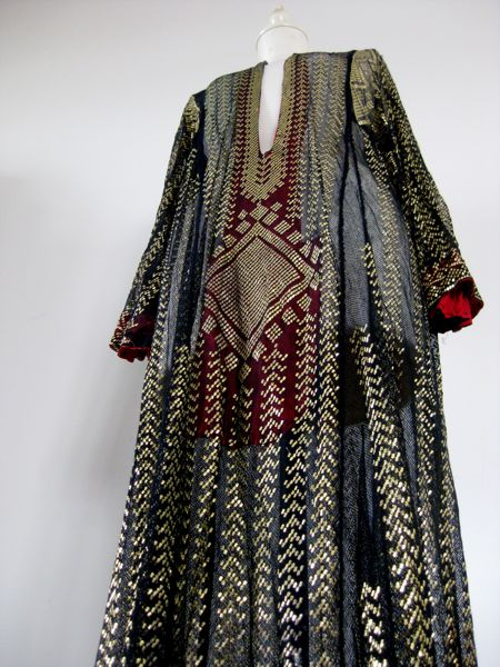 Tunic with brilliant gold metal assuit patterning on black net