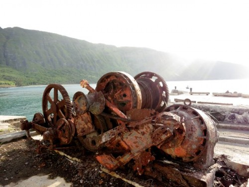 Old shipping gears, Kalaupapa warf, with the pali behind