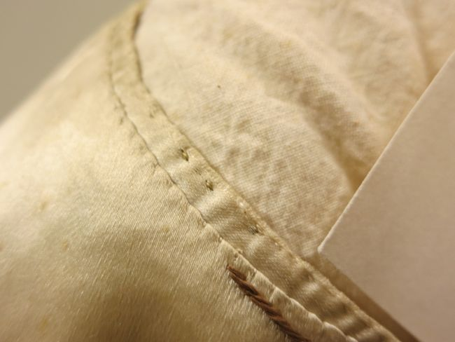 Whip stitching and running or back-stitch around the collar