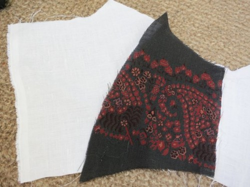 Linen bodice assembled, sewing down the first piece of the wool