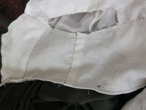 The folded back and sewn down waist seam