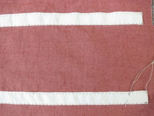Detail of the sewn-down hoop tapes