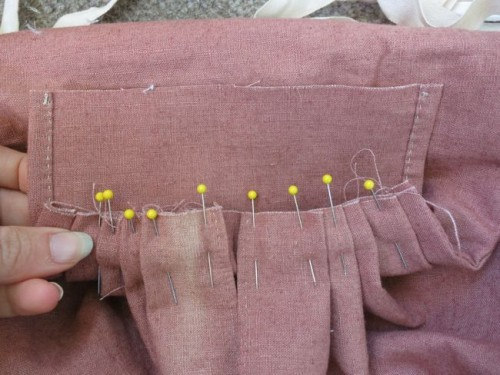 Checking the pleated bag against the waist piece