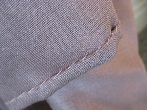 Whipstitched rolled hem