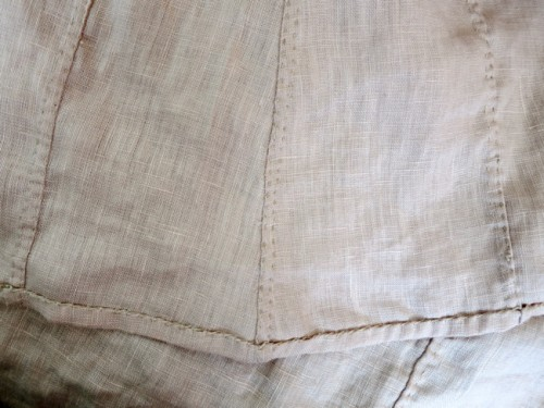 Flat-felled seams and whip-stitched hems