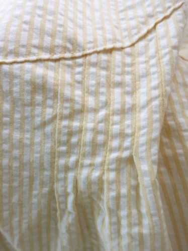 Stripe-matched pintucks in the bodice front