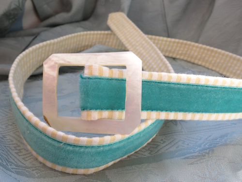 The belt, with vintage shell buckle and velvet ribbon