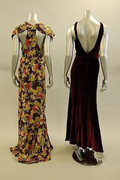 Two evening gowns (back), 1930s. Left- Floral-printed crepe with bustle back and trained skirt. Right- Wine velvet with matching belt with millefleur beaded buckle.