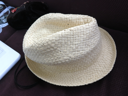 Hat without all the ribbons or trims removed