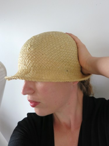 Reshaping the dampened paper fedora