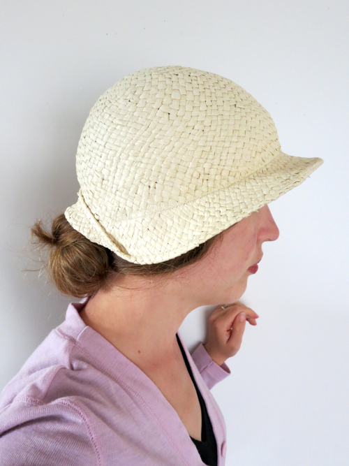Hat held snugly on by hat elastic