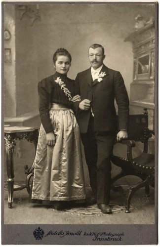 1890s couple, the woman in a creased silk satin skirt, via valerieanasolaris on Flickr