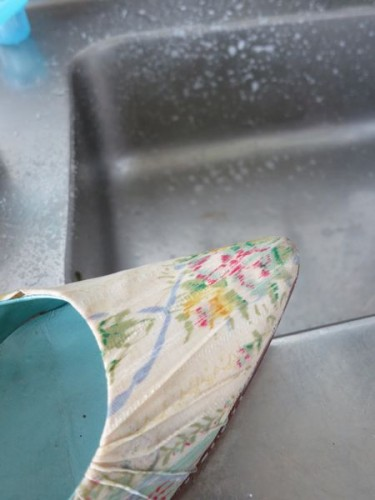 You want to clean the shoes while keeping them as dry as possible, so it's important to get most of the water off of your toothbrush, so the shoe gets barely damp.