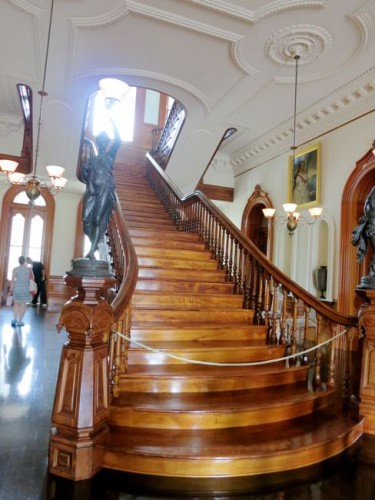 The grand koa staircase in the Great Hall