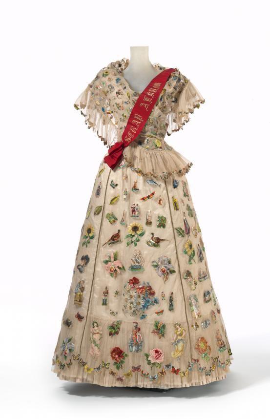 """Scrap Album"" fancy dress. Circa 1893, Made of silk, cotton, linen, paper, glue, metal (fastening), wood, leather, baleen, wax, and paint, England. Madame Gough, London (court dressmaker), Sarah Ann Gough (designer) National Gallery of Victoria"
