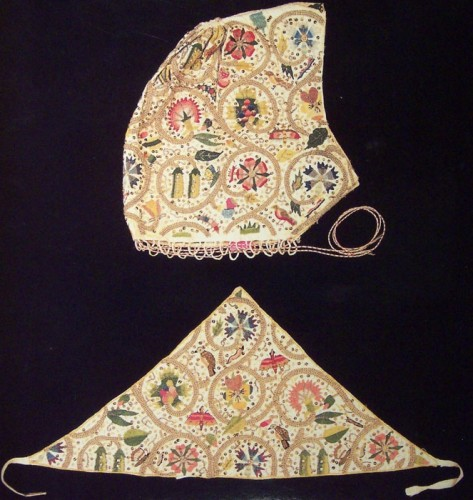 Coif and forehead cloth embroidered in colored silks and metal threads, interspersed with spangles. Probably last decade of the 16th century