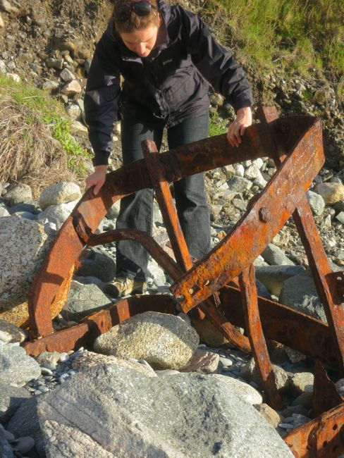 Abandoned coal bucket on the beach, West Coast New Zealand