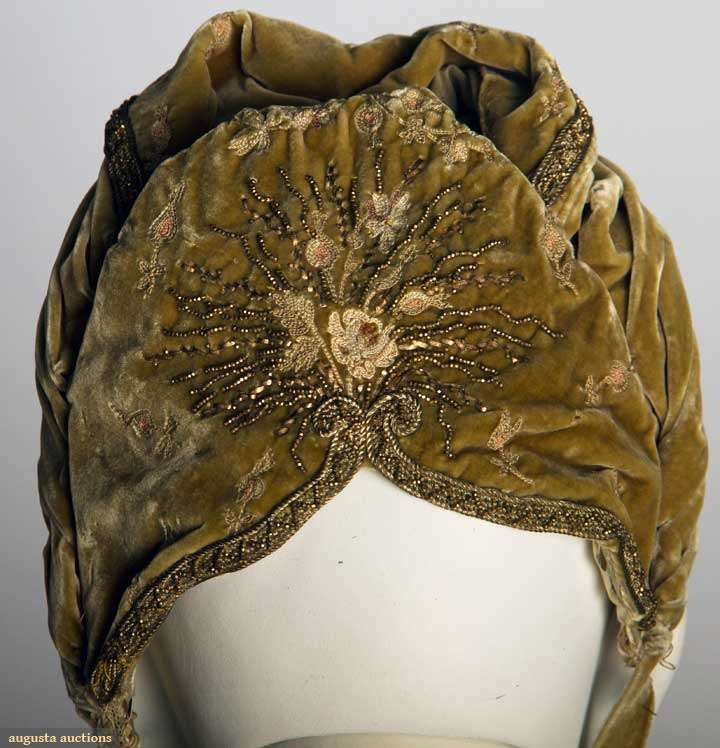 Evening ensemble with matching bonnet, French, c. 1890 silk velvet tambour embroidered in rose blossom pattern, gold beadwork on cloth of gold collar & bodice appliques, stamped 'A. Felix Brevete 15 Faub. St. Honore Paris', Augusta Auctions