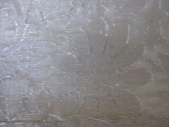 A variant of brocade with cut threads on both sides of the fabric, forming voided designs