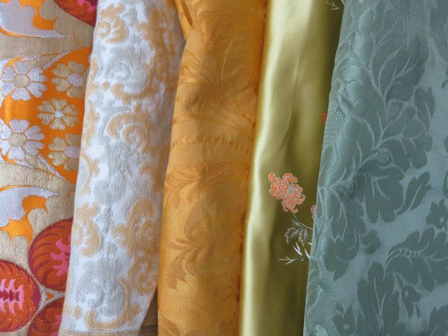 Left to right: Imperial brocade, tapestry/brocatelle, damask, brocade, damask