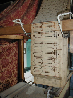 Punch cards in use on a Jacquard loom at the Museum of Science and Industry, Manchester, England