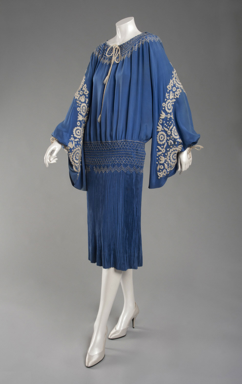 Dress, bright blue silk plain weave, blue and white smocking, and white embroidery, Philadelphia Museum of Art, 1956-50-1