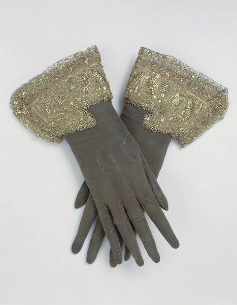Pair of gloves, English, 1660s, Leather embroidered with silver and silver-gilt thread, silk ribbon and spangles, V&A T.225&A-1968