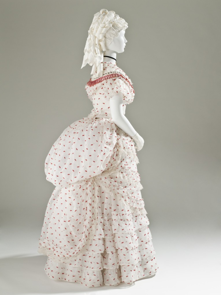 Woman's Polonaise Dress, England, circa 1875, Cotton plain weave with wool of discontinuous supplemental weft, silk satin ribbon, and machine lace, LACMA, M.2007.211.777a-f