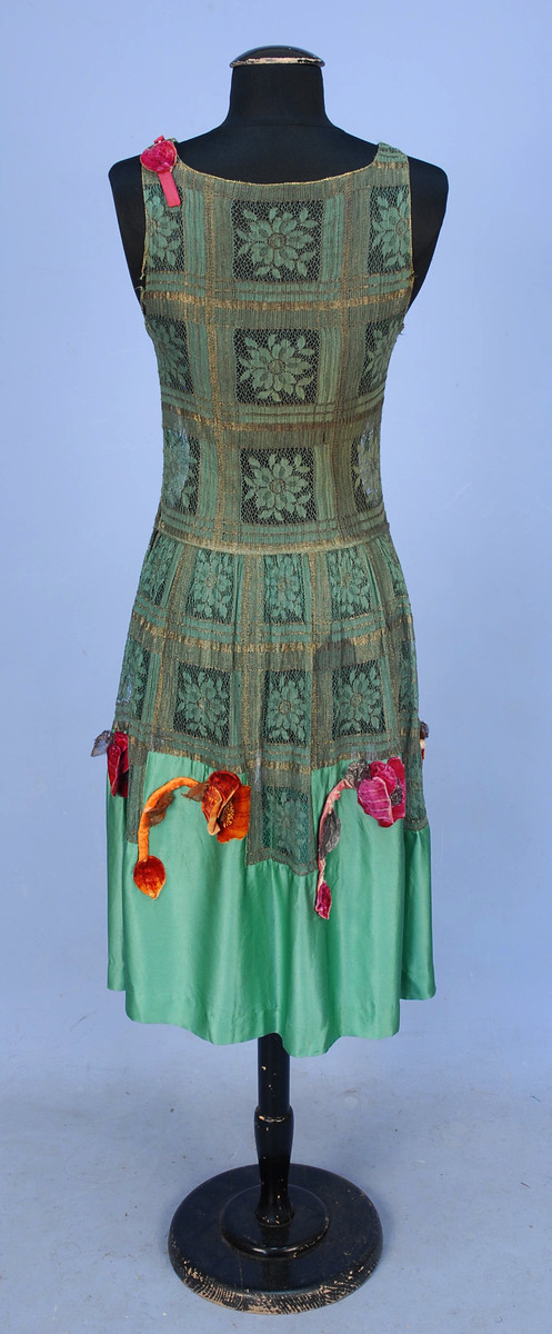 Evening dress of metal and cloth lace with silk charmeuse and appliquéd silk velvet poppies, 1920s, sold by Whitaker Auctions
