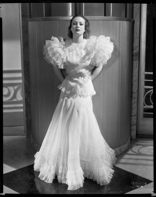 Joan in Adrian's legendary Letty Lynton gown (1932)