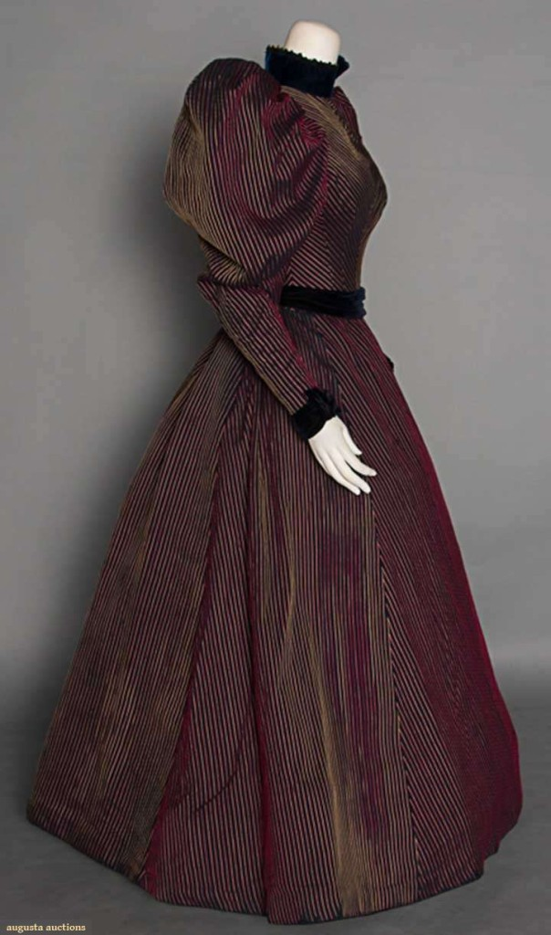 1890s day dress of black cotton with raised red & yellow stripes, with black velvet trim.  Sold by Augusta Auctions, Nov 12 2014