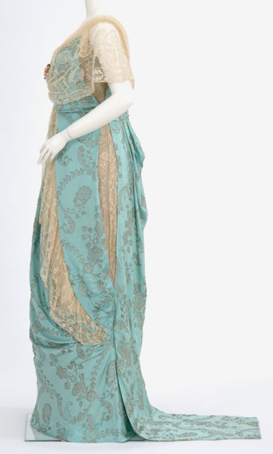 Evening dress of robins egg blue satin, brocaded in silver, with blond lace trim, Elizabeth Elser, Minneapolis, Minnesota, ca. 1914, Minnesota Historical Society, 8879.98