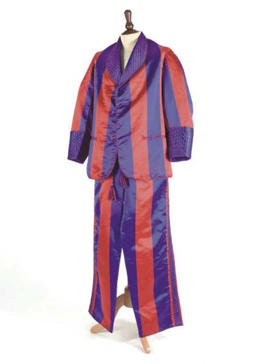 BEALE & INMAN, A GENTLEMAN'S SMOKING SUIT c. 1900 vivid red and purple silk satin suit comprising drawstring trousers and jacket, with quilted lapels and accents, sold at Christies