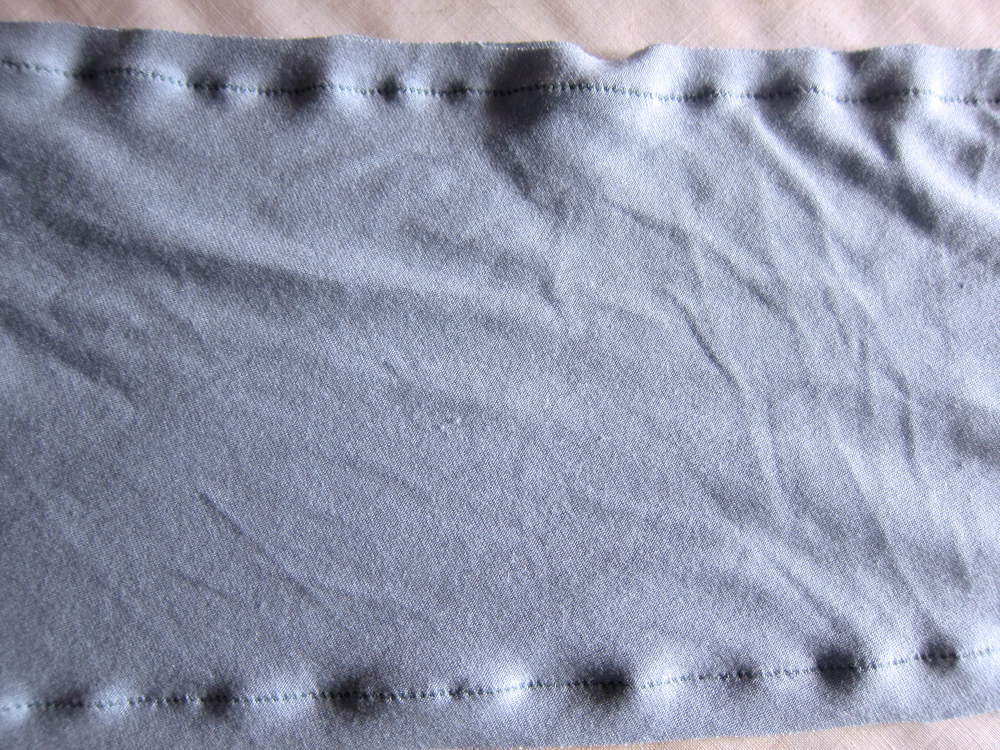 Rippling along the lightning-stitched sleeve of my grey-blue wool crepe Miramar dress