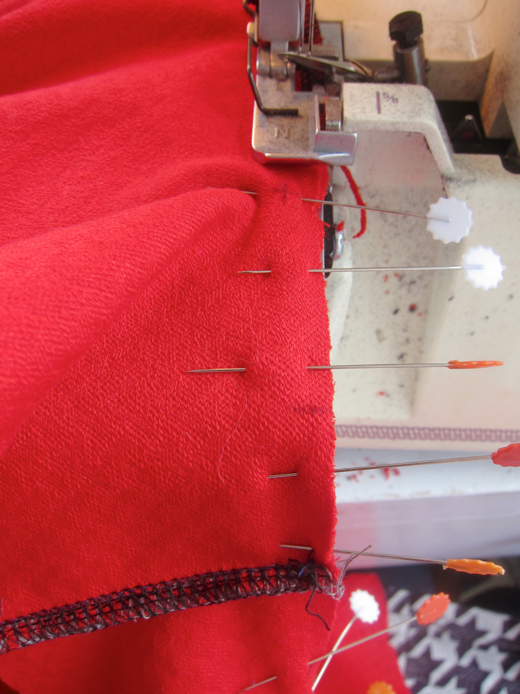 Sewing the neck seam of a Miramar with an overlocker