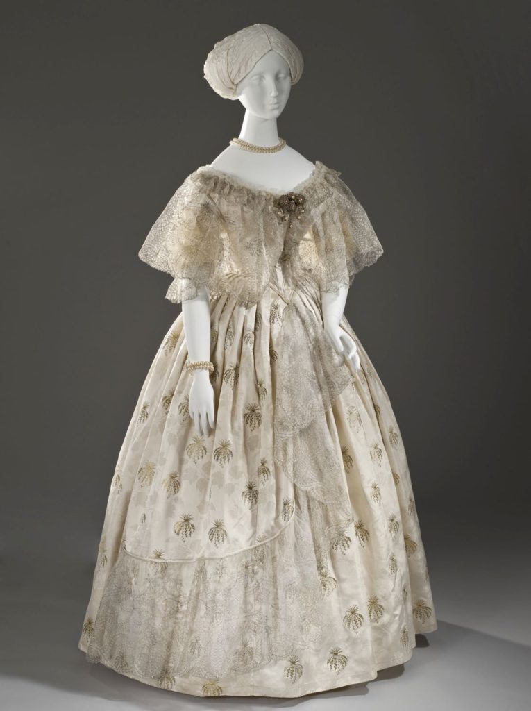 Evening dress, ca. 1850, Silk satin with silk and metallic-thread supplementary patterning and silk net with metallic-thread embroidery, M.2007.211.872a-b