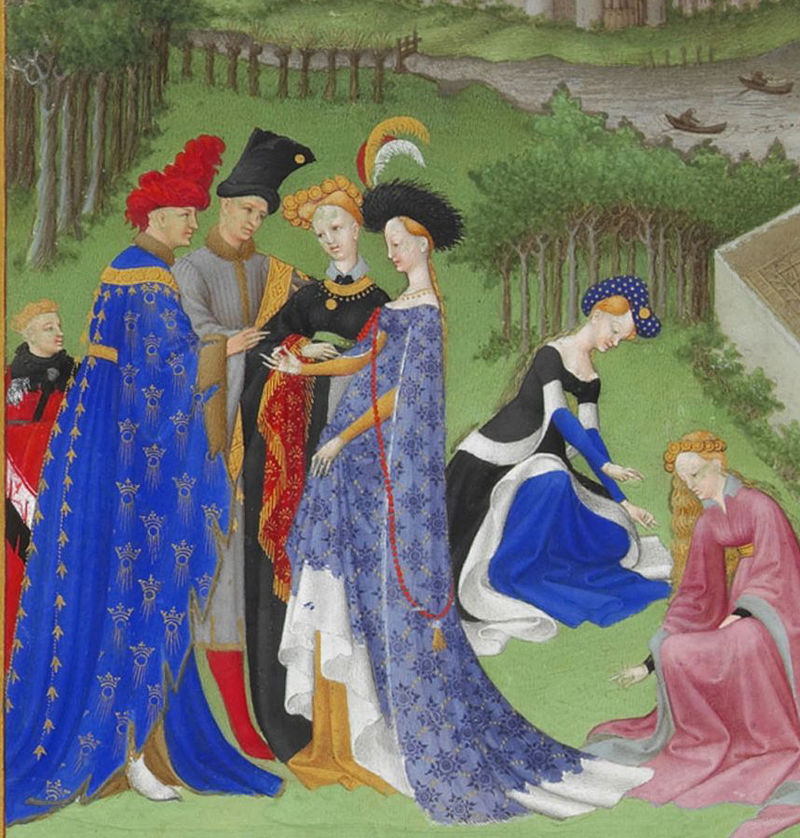Full-bodied houppelandes with voluminous sleeves worn with elaborate headdresses are characteristic of the earlier 15th century. Detail from Très Riches Heures du Duc de Berry