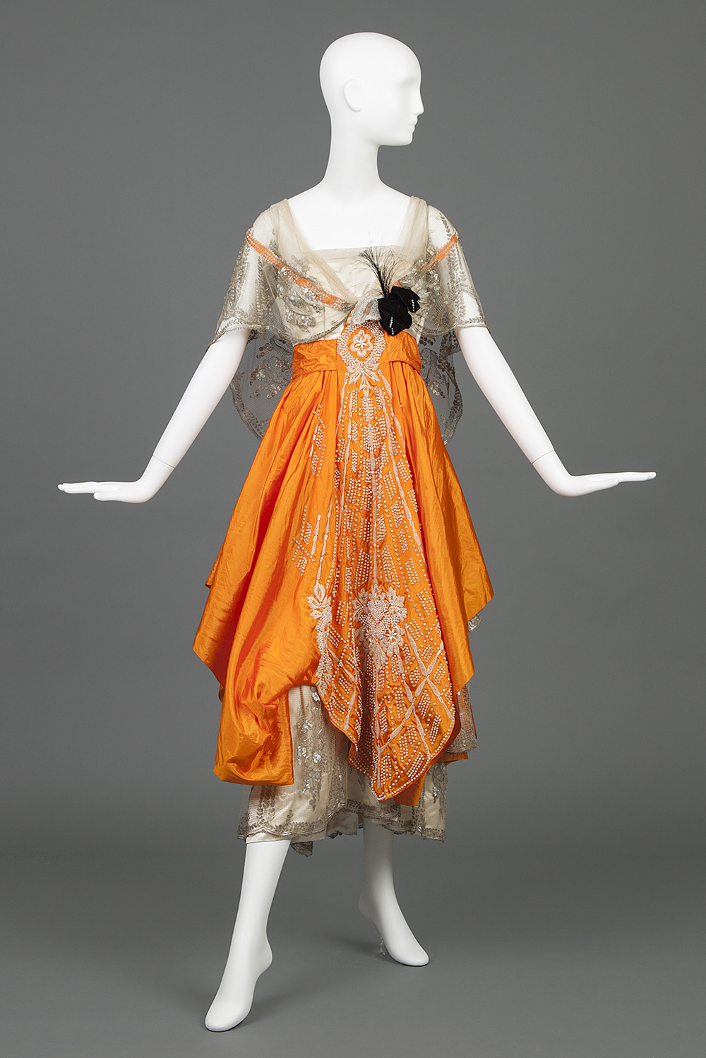 Evening Gown Of Cream Silk Satin and Orange Silk Taffeta, Hollander, L.P., 1916-1917, USA, silk, pearl beads, chenille yarn, aigrette feathers, Goldstein Museum of Design 1982.016.015 detail