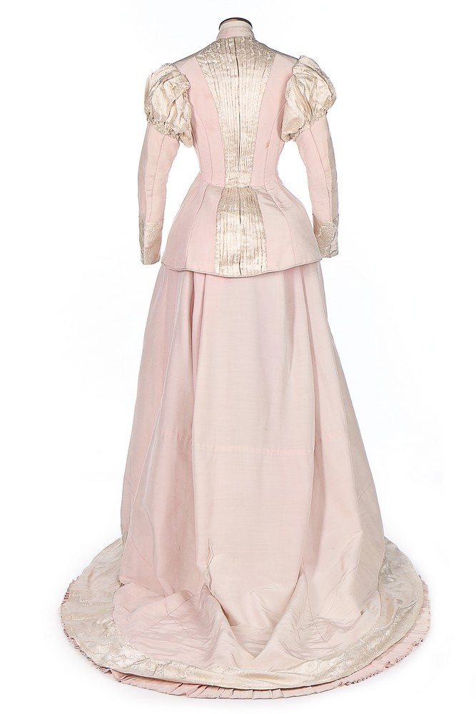 A pink faille and ivory damask historicist evening gown (dinner or reception?), 1875-80, sold by Kerry Taylor Auctions