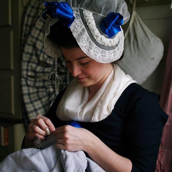 Amber of Virgil's Fine Goods, photo taken by Carol Kocian while at Colonial Williamsburg's Margaret Hunter Millinery Shop