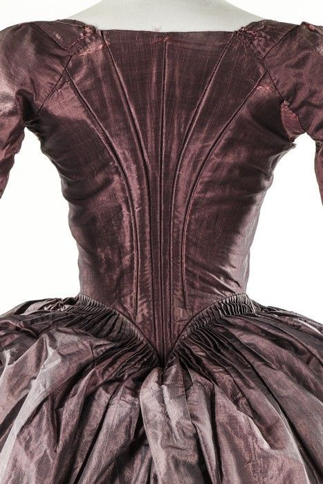 A shot mauve-grey silk gown, late 1770s. with boned, low pointed back panels, internal skirt loops, the sleeves applied with 1770s double tiered embroidered muslin engageants sold by Kerry Taylor Auctions