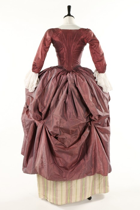 A shot mauve-grey silk gown, late 1770s. with boned, low pointed back panels and internal skirt loops, sold by Kerry Taylor Auctions