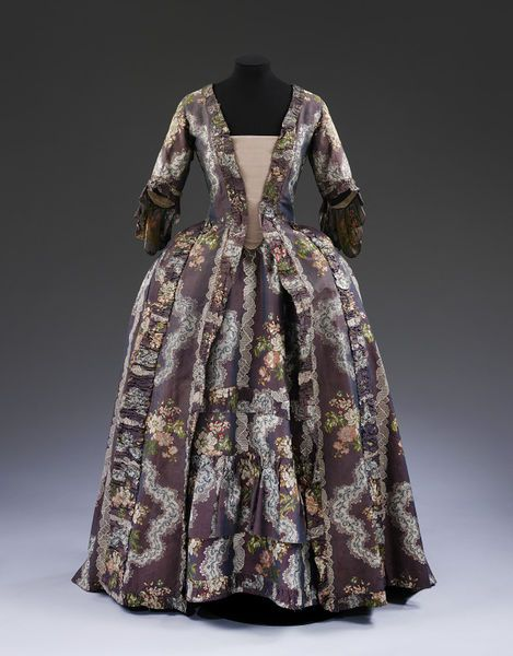 Sack and petticoat, purple silk, brocaded with flowers and lace, French, 1765-1770. Museum Number T.708&A-1913.