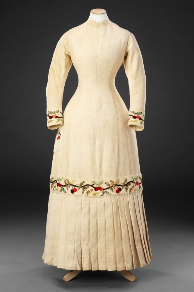 Dress, Circa 1880, Cotton embroidered with wool; mother of pearl buttons, John Bright Collection.jpg