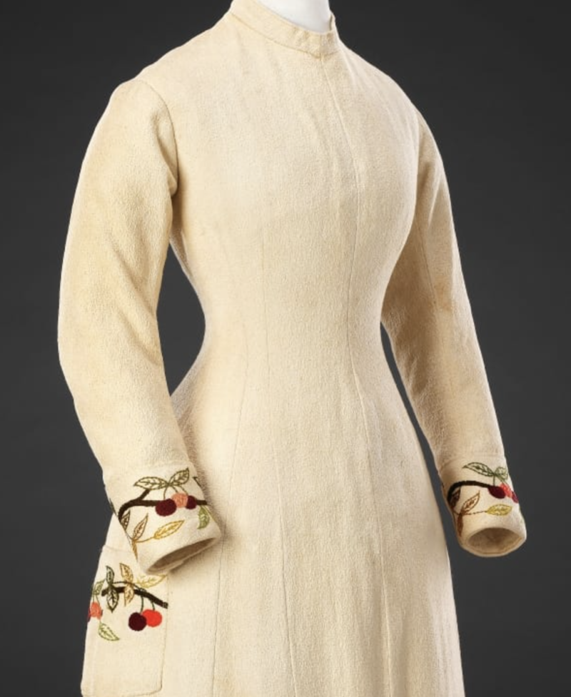 Dress, Circa 1880, Cotton embroidered with wool; mother of pearl buttons, John Bright Collection