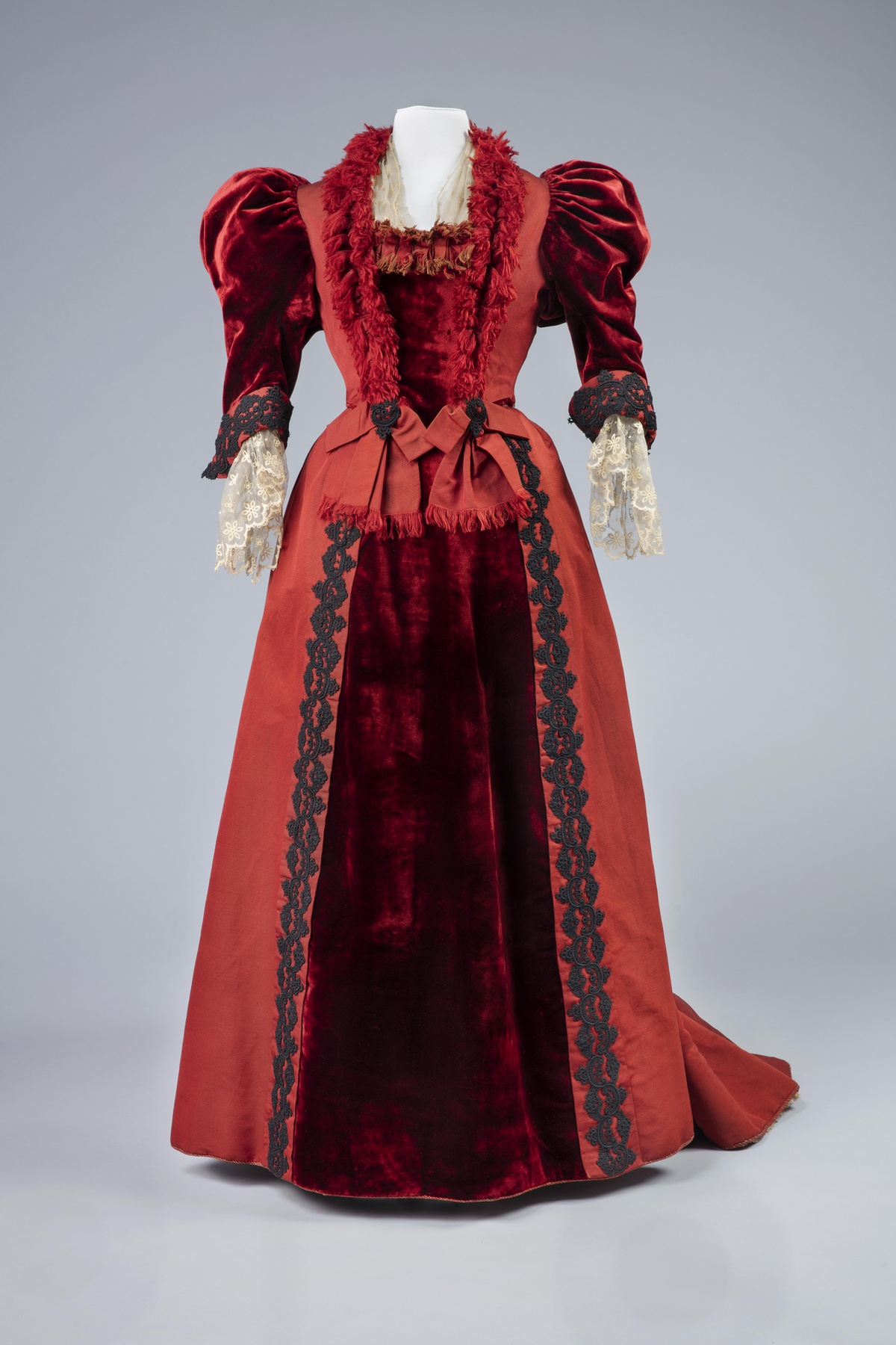A mid 1890s dress in red silk and red silk velvet, with puffed sleeves, Dress in two parts, 1896, silk, lace and passementerie, 10592:001-002 Centraal Museum Utrecht