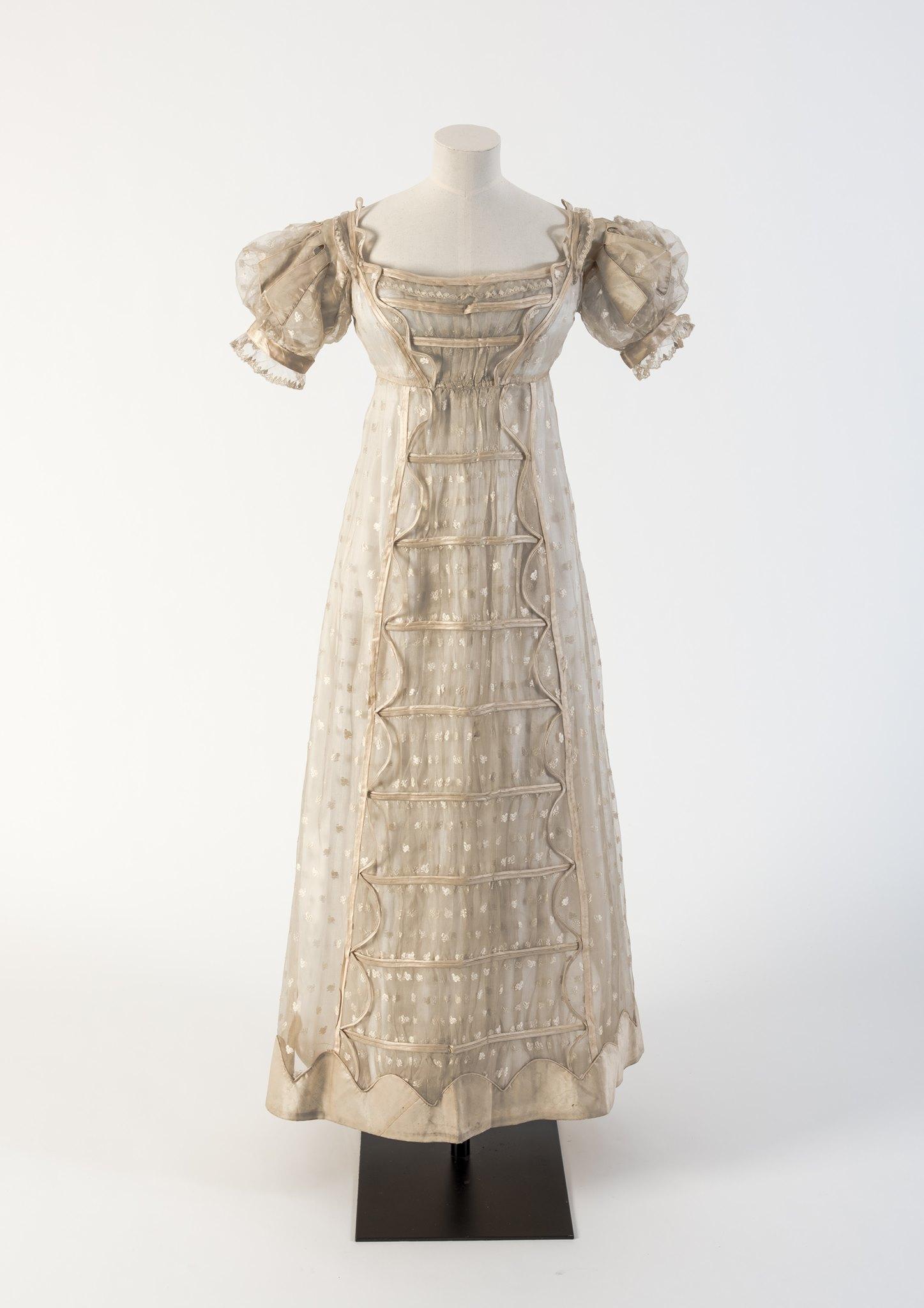 Evening dress, 1817, patterned silk gauze called 'Madras lace' with silk satin trim, Fashion Museum Bath