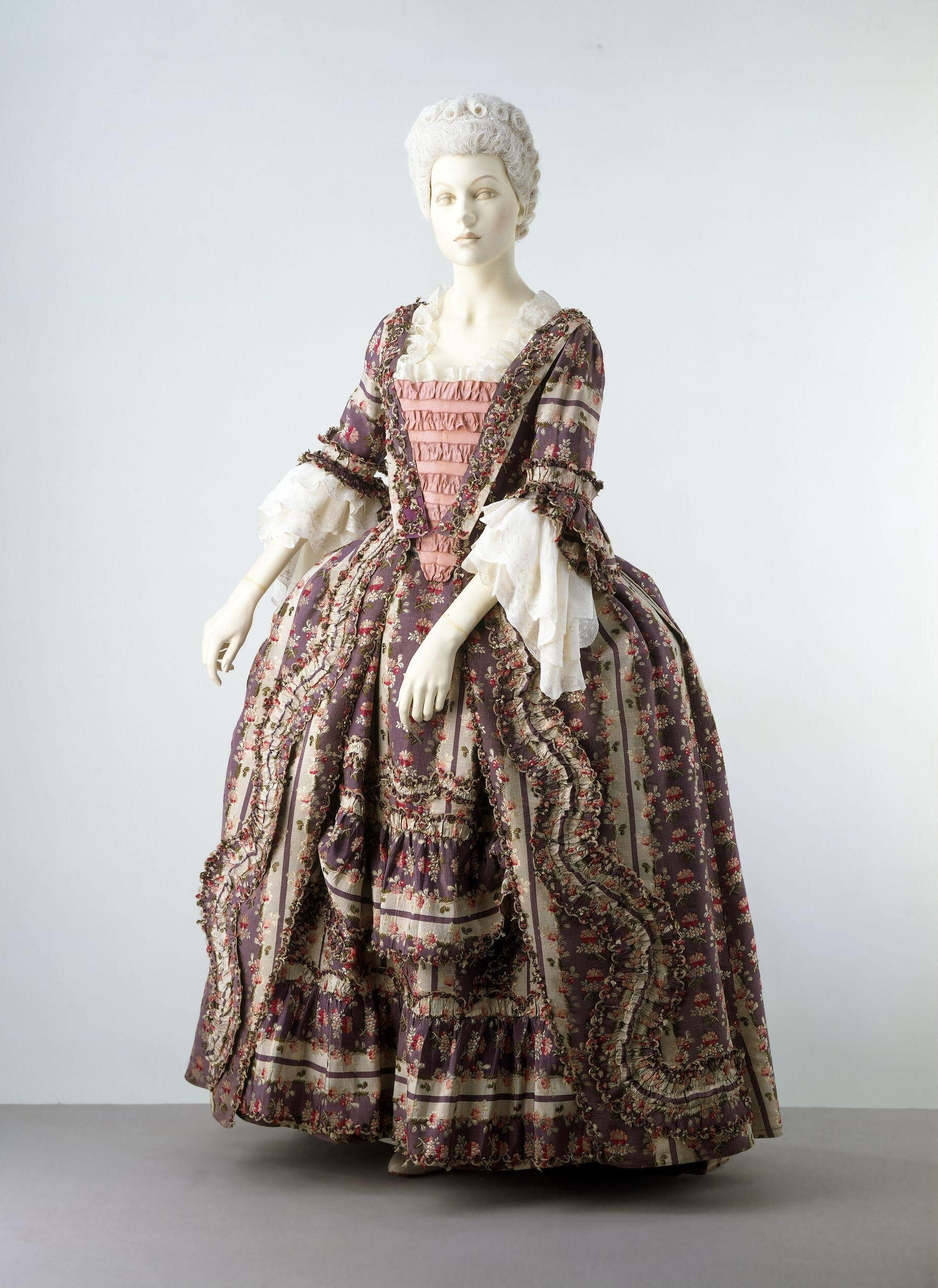 A woman's sack and petticoat, English, 1770-75; purple and white striped silk with flowers, Spitalfields or French, 1770-75, Victoria and Albert Museum T.161&A-1961