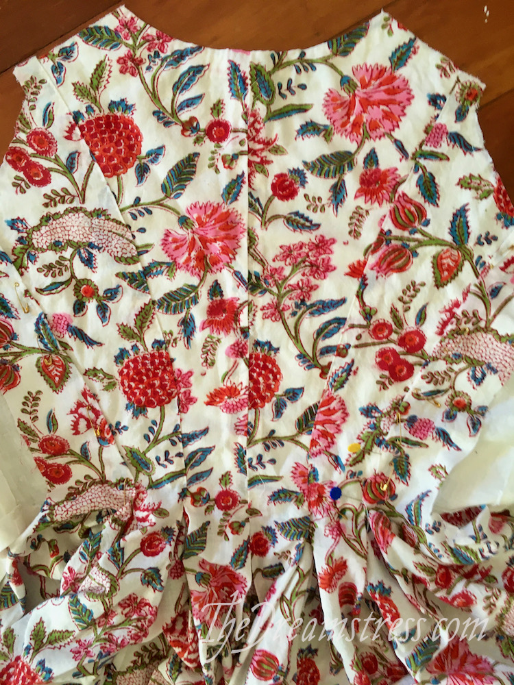 A partly made 1780s jacket in bright floral fabric