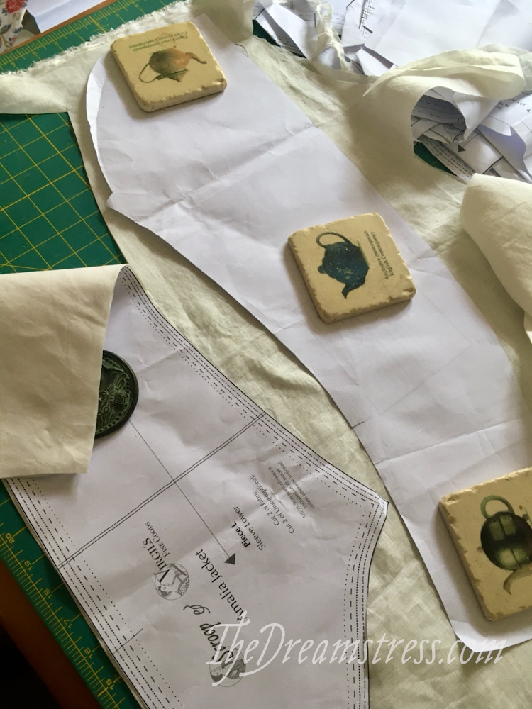 Sleeve pattern pieces lying on ivory linen